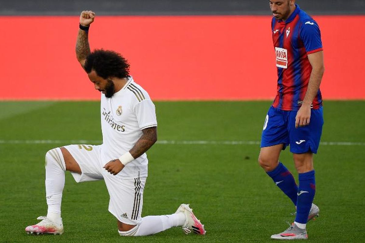 Real Madrid's Marcelo takes a knee in support of Black Lives Matter movement