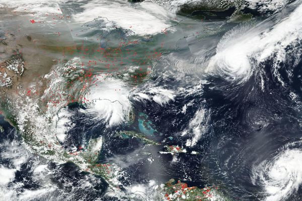 NASA's Aqua satellite captured this true-color image of the United States on Sep. 15, 2020, showing the fires in the West, the smoke from those fires drifting over the country, several hurricanes converging from different angles, and Hurricane Sally making landfall.