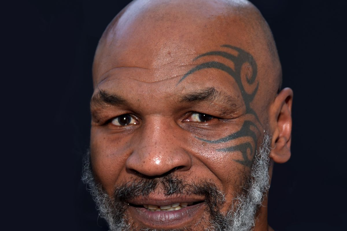 Mike Tyson returns to boxing in an exhibition match against Roy Jones Jr.