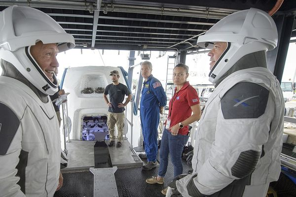 Doug Hurley (left) and Bob Behnken (right) at crew extraction rehearsal from SpaceX's Crew Dragon