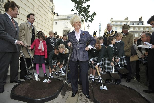 The late Barbara Windsor, actress and local resident, plants last of 53 trees to be added to Weymouth Street, London in 2010.