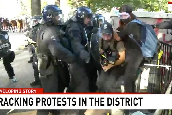 A screen-capture shows Network Seven cameraman Tim Myers and reporter Amelia Brace as they were assaulted by police officers while covering protests outside the White House