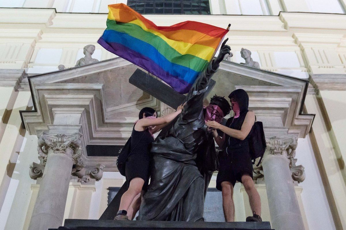 Three suspects arrested after pride flags had been placed on statues in Warsaw
