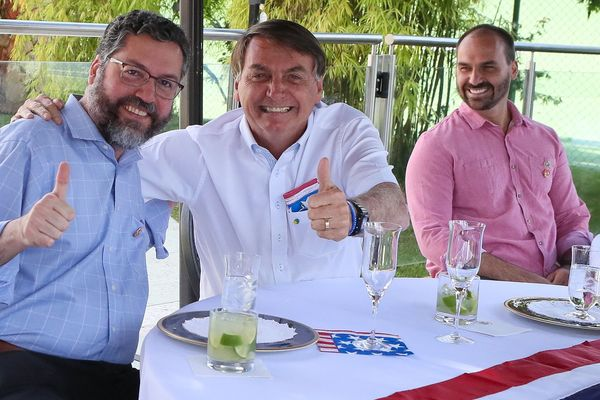 Jair Bolsonaro (centre) pictured at the United States Independence celebration on July 4.