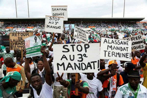 "Tweet reads: ""Supporters of Ivory Coast's Coast opposition coalition parties hold signs during a stadium rally to protest against president Alassane Ouattara's bid for a third term in Abidjan, Ivory Coast, October 10, 2020. The front sign reads: ""Stop to a third term""."