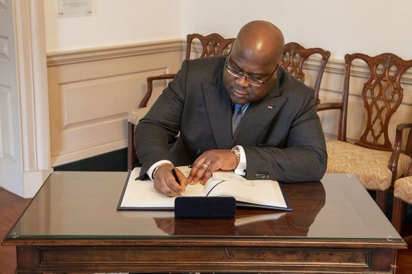 Democratic Republic of the Congo President Félix Tshisekedi signs the guest book, at the Department of State, on March 3, 2020