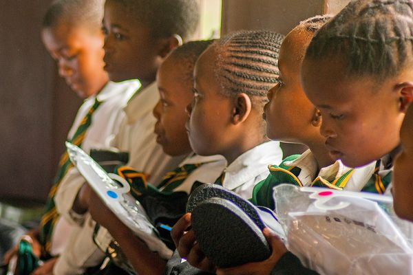 School children from KwaMangqakaza Primary School receiving school uniforms that were donated by a good Samaritan. South African schools are expected to begin a phased re-opening from the 1st of June 2020.