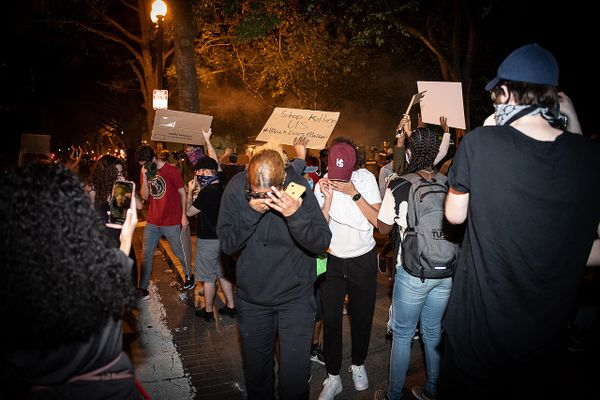 Protesters react to tear gas at George Floyd protests in Washington, D.C.