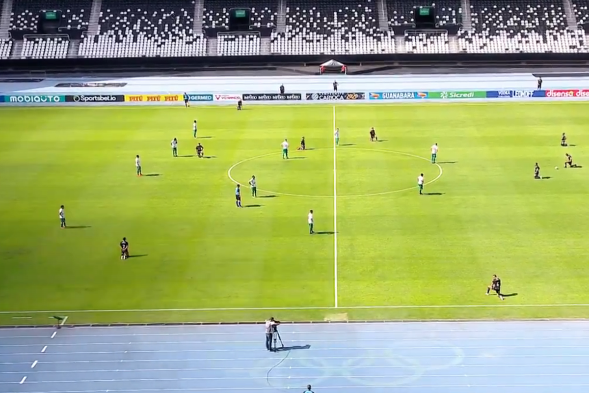 Botafogo players 'take a knee' during a match in Brazil
