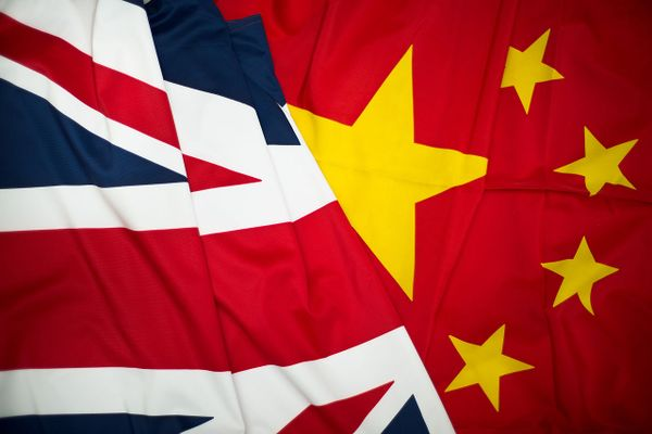 Image shows the Union and Chinese Flags together.
