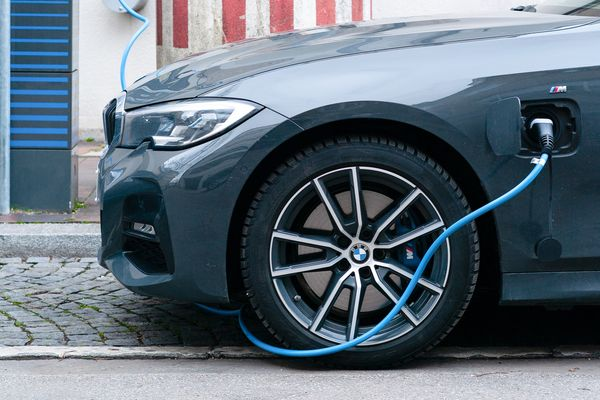 BMW electric hybrid vehicle on charging station in Munich