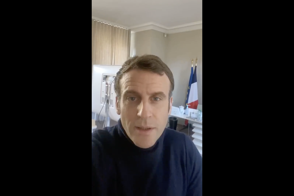 Video still of Macron's video message
