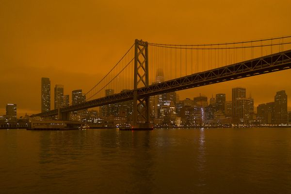 Smoke from the North Complex fire settles over San Francisco, turning the daytime sky a dark orange.