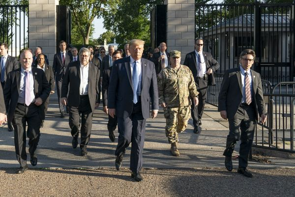 President Donald J. Trump walks from the White House, Mark Milley in a military uniform