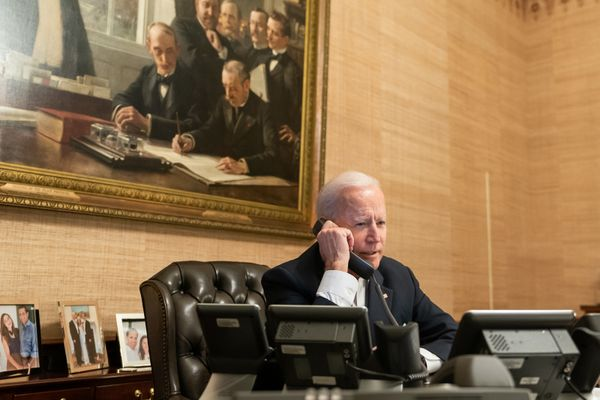 President Joe Biden talks on the phone with Texas Gov. Greg Abbott