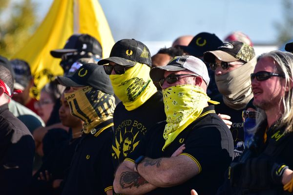 Masked Proud Boys stand at a protest in Raleigh, North Carolina in November 2020.
