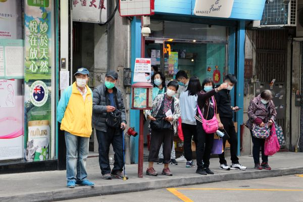 Elderlies wearing face masks at a Bus stop in Macau, China
