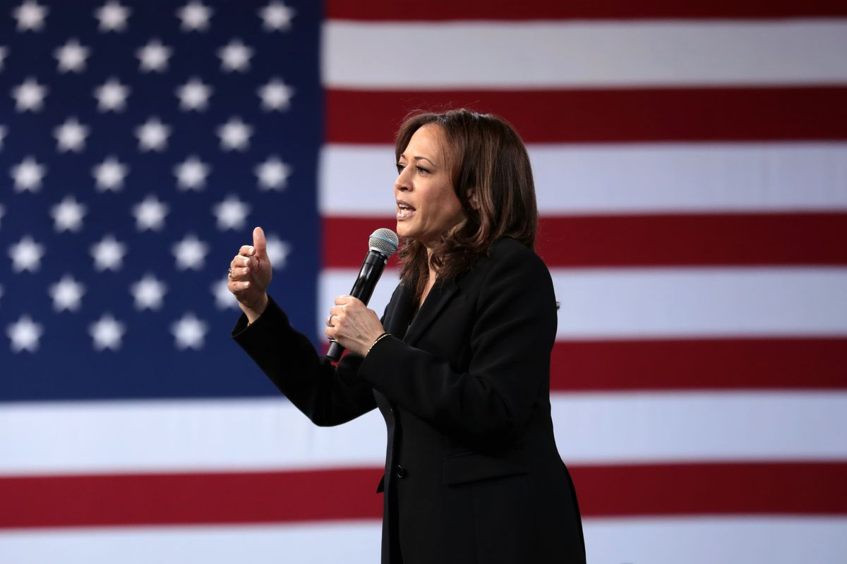 Kamala Harris halts travel after two people linked to the campaign test positive for Covid-19
