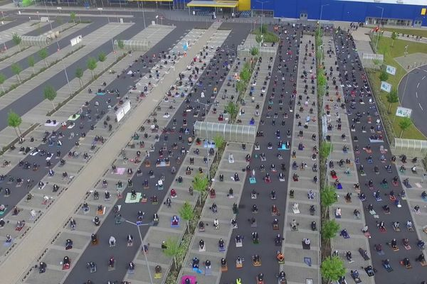 Muslims praying in IKEA car park