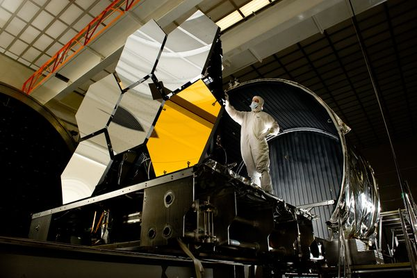 Ball Aerospace lead optical test engineer Dave Chaney inspects six primary mirror segments, critical elements of NASA's James Webb Space Telescope, prior to cryogenic testing in the X-ray & Cryogenic Facility at NASA's Marshall Space Flight Center in Huntsville, Ala