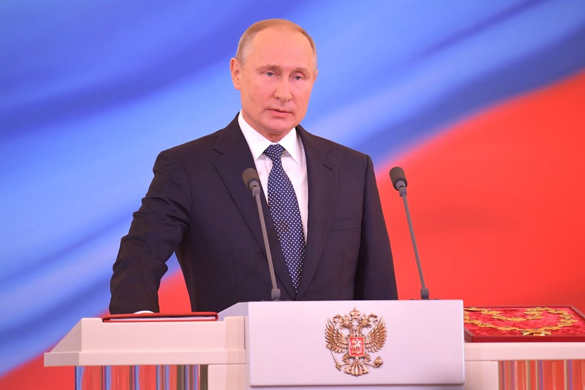 Putin signs law allowing him 2 more terms as Russia's President
