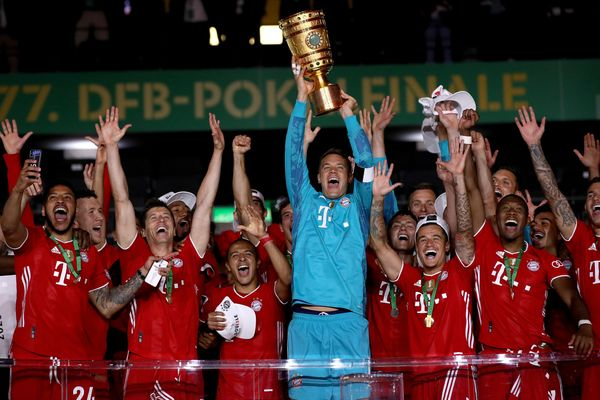 Bayern Munich captain ManuelNeuer lifts the German Pokal trophy