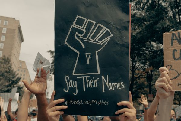 """""""Say Their Names"""" sign at a BLM protests in D.C."""